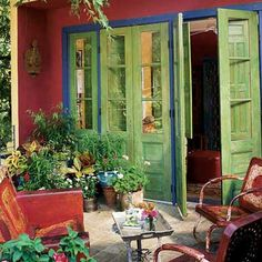 Sizzle and Spice    Mexican-born designer Verónica Prida infused the outdoor living area of her San Antonio home with the spirit of her native country. The doors were salvaged from a soon-to-be-razed schoolhouse in Monterrey, Mexico.    RESOURCES: Interiors, Verónica Prida, Prida Design