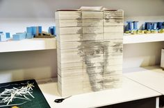 Amazing portrait of Mark Zuckerberg slicing the ends of 36 books to create different shades, by Red Hong.