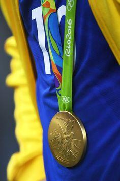 Neymar Photos - Neymar of Brazil celebrates with his gold medal following the…