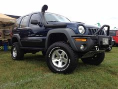 lifted jeep liberty | JBA is the first production coilover lift kit for the Jeep Liberty