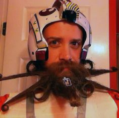 This is Chad Roberts' X-Wing Fighter inspired beard. It looks like an X-Wing Fighter from Star Wars, but it's not -- it's all hair. No word if the ship-beard is capable of ion torpedo-ing any thermal. Starwars, X Wing Fighter, Tie Fighter, Fighter Pilot, Epic Beard, Awesome Beards, Image Of The Day, Beard No Mustache, Cool Halloween Costumes
