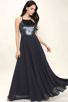 Feel like the princess you were born to be in the Cotillion Matte Navy Blue Sequin Dress! Matte sequins cover a princess-seamed bodice, with an apron neckline and adjustable spaghetti straps that crisscross at back. Fitted waist tops a cascading chiffon maxi skirt.