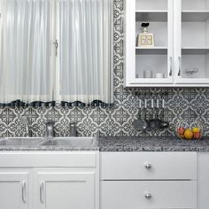 The Lima Ceramic Tile in Black has the industrial appearance of cement and an intricate, symmetrical design. This encaustic piece features a fleur-de-lis white and ash gray design on a charcoal gray background. This durable tile is semi-vitreous, great for indoor applications.