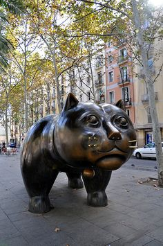 El gato de Botero | Rambla del Raval, Barcelona - they demolished an entire street of apartment buildings to create the new Rambla del Raval - now the area is an open plaza with palm trees and this happy chappy - which I can't imagine the previous tenants were very pleased with :S nevertheless, we thougt he was awesome! And yes, he's definitely a he XD