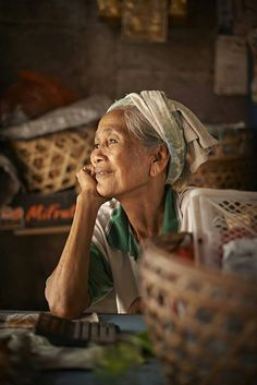 An old lady working her stand at a Balinese market/ Bali.