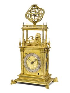 A 17th Century gilt brass table clock. A very rare and important first half of the 17th Century continental gilt brass automata table clock with geared armillary sphere