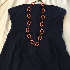 "Navy strapless dress Worn once, like new. EUC Navy dress. Rubber lining around the top to prevent it from slipping. The dress is cotton and spandex. It's a Large Petite. It fell about 2 inches above my knees and I'm 5'2"". Old Navy Dresses Strapless"