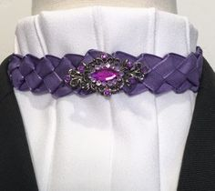 Single bib with topstitched pleats over the ultra low collar style tie. Braided satin edged linen purple ribbon. Vintage filigree pin with 2 color purple rhinestones included.