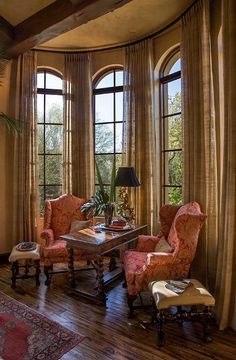 Love this sitting area. The windows are gorgeous. The draperies simple yet flowing elegance. Notice the rod installment. Love this space.