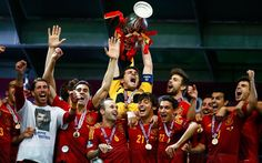 Spain's Iker Casillas lifts up the trophy after beating Italy 4-0 to win the Euro 2012 final at the Olympic stadium in Kiev
