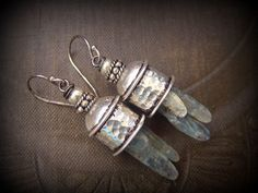 YuccaBloom   Blue Kyanite Earrings, capped with Silver Beads.