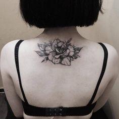 Upper back tattoo of a rose. Tattoo artist: Zihwa
