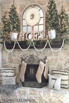 These super soft Flokati inspired pillows and a cozy, faux fur rug from HomeGoods add warmth and texture to our farmhouse inspired Christmas mantle! {Sponsored Pin}