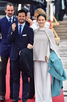 Prince Carl Philip and Princess Sofia of Sweden arrive for King Harald's and Queen Sonja's 80th birthday Lunch on the  Norge yacht. Princess Sofia of Sweden was the epitome of casual chic as she covered her burgeoning baby bump in a neutral cape with gold buttons, teamed with white, wide-legged trousers.