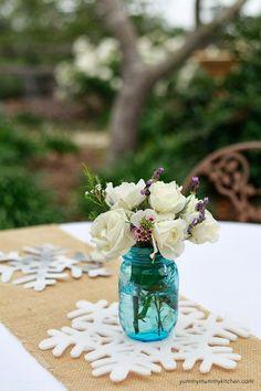Disney Frozen Themed Birthday Party: White Flowers in a Blue Mason Jar on a Snowflake Decor/Centerpiece