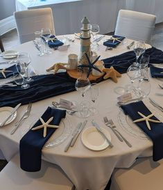 Navy Blue and White Beach Themed Wedding Table Decor and Centrepiece at The Green House Hotel Nautical Wedding Centerpieces, Beach Wedding Tables, Wedding Table Themes, Blue Beach Wedding, Beach Wedding Centerpieces, Nautical Wedding Theme, Wedding Venue Decorations, Wedding Table Settings, Nautical Table