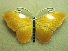 This enormous bold orange butterfly brooch was made by O. F. Hjortdahl, another outstanding Norwegian sterling and enamel master. His work stands toe-to-toe with any made by Marius Hammer.