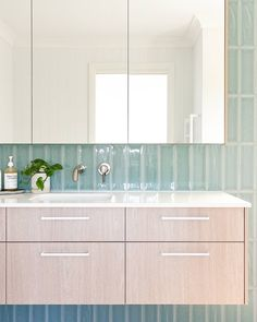 Your Beautiful Home - In this clean, minimalist and bright bathroom, Sydney-based design studio created an inspiring, soothing space with perfect seafoam green tiles from @tiles_by_kate , timber wall-mounted floating vanity and benchtop in Smartstone Nieve White. #smartstone #Bathroom #renovation #Bathroomideas #Bathroomdesign #renovationideas #renovationBathroom