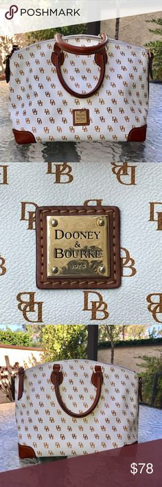 Dooney & Bourke Gretta Large Satchel Excellent condition.  Very clean . One inside zippered compartment, 3 inside pockets. Comes with shoulder strap which is still in original packing. Dooney & Bourke Bags Satchels