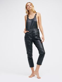 Lilah Leather One Piece | Effortlessly cool real leather one piece featuring braided trims and a four pocket design. Straps feature a front tied accent for a lived-in look. High rise with a slim fit through the leg. Open back. Hidden side zipper.