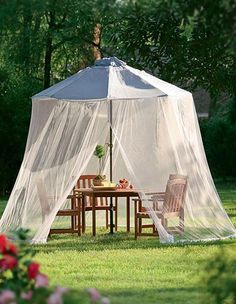 Super stylish and inexpensive, mosquito netting can serve as a decorative outdoor curtain as well as functional mosquito protection.