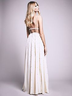 Silver Screen Maxi | Be the night's brightest star in this beautifully intricate maxi dress. Featuring allover sparkling embellishments and strappy back, this look is sure to stun. Sweeping, ethereal silhouette that makes for a true statement. Hidden side zip for an easy fit.
