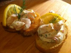 """Skagenrøre or """"Skagen Toast"""" - a delicious creamy shellfish salad with shrimp and crayfish with lemon juice, dill and chopped hardboiled eggs. Get the recipe here http://arcticgrub.wordpress.com/2013/06/21/sankthansaften-norways-summer-solstice/"""