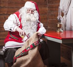 Santa adding one more gift to his sack. Photo courtesy of Visit Finland © MEK Finnish Tourist Board.