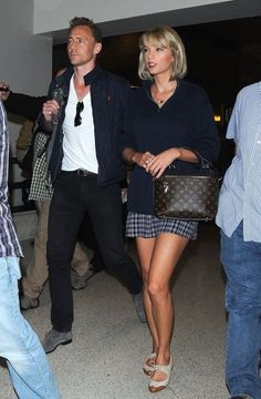 Taylor Swift Photos Photos - Couple Taylor Swift and Tom Hiddleston are seen arriving on a flight at LAX airport in Los Angeles, California on July 6, 2016. - Taylor Swift and Tom Hiddleston Land at LAX