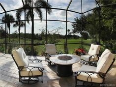 Firepit under the screened lanai with a golf course view - lovely place to sit on a cool winters night in Kensington in Naples, FL Lanai Room, Lanai Porch, Screened Porch Designs, Screened In Patio, Lanai Decorating, Decorating Ideas, Outdoor Rooms, Outdoor Living, Florida Home