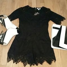 REDUCED DARING LACE LOVERS BLACK ROMPER Show off those beautiful legs with this Black Lace Romper. LACEY AND SEXY. Back has brushed  gold tone exposed zipper and is fully lined.  Add any color shoes and bag to complete the look! Pants Jumpsuits & Rompers