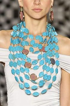 Plastic Beads? Real Turquoise? Molded & Dyed Magnesite? Can't tell but it is an impressive Turquoise colored necklace.