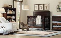 Dark furniture and light blue nursery for a boy. Change the blue to a light pink for a girl.