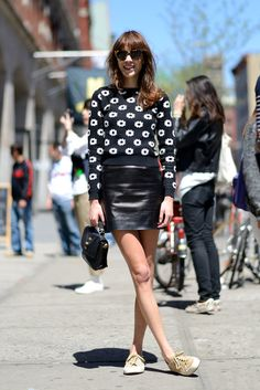 Summer Has Never Looked Better, Thanks to This Street-Styled Set: We're smitten with Alexa Chung's accessible play on Summer leather. Add a sweet knit and your favorite sneakers to temper any sexiness of the leather miniskirt. Source: Le 21ème | Adam Katz Sinding
