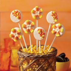 Wilton Candy Corn Cookie Pops from @officialacmoore.  Prepare to be a-maize-ed! This fall flavored lollipop brings candy corn and cookies together to create a corny treat everyone will love!