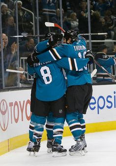 San Jose Sharks forwards Joe Pavelski, Joe Thornton and Tomas Hertl celebrate Hertl's first period goal (Dec. 13, 2014).
