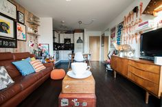 As with all good homes, a tour of this one-bedroom flat in East London is like walking inside the mind of its owner. Lego, typographic prints, Barbie dolls, taxidermy, train station signs and a giant teacup all sit under the same roof. It's an eclectic mix, but owner Tom Chalet makes it work.