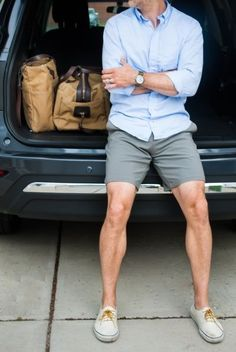 Shop this look on Lookastic:  http://lookastic.com/men/looks/long-sleeve-shirt-shorts-plimsolls-duffle-bag-watch/11343  — Light Blue Long Sleeve Shirt  — Olive Leather Watch  — Tan Canvas Duffle Bag  — Grey Shorts  — White Plimsolls