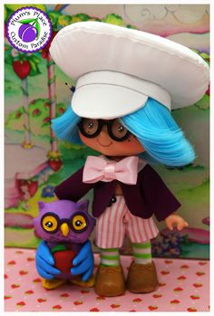 """This Custom Plum Puddin' Boy Doll is inspired by the Plum version in the vintage children's story book """"The Adventures of Strawberry Shortcake and her friends"""". Made by Plum's Place Custom Paradise."""