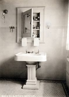 "Vintage style in an actual vintage bathroom. We love the pedestal sink, tile floor and the medicine cabinet. The sconce, no so much. || A ""modern bathroom"" from the 1920s (National Archives of the UK)"