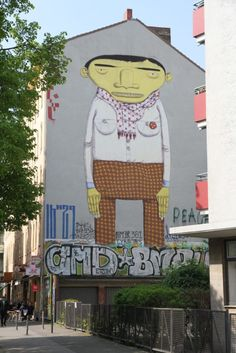 Street art and graffiti works by Os Gemeos, Victor Ash, JR, and Blu.