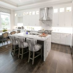 This cozy kitchen has comfortable seating gorgeous custom cabinetry and lots of luxurious marble! I love how it all came together.  Happy Sunday  stools: @lazarfurniture  table & chairs: @hookerfurniture  photo: @palmbeachcreative