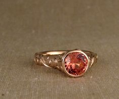 Carved art nouveau style solitaire in 14K rose gold w/padparadscha sapphire