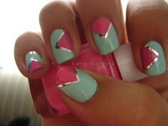 A playful nail art design making use of a sea green and pink color combination divided by silver metallic strips on top.