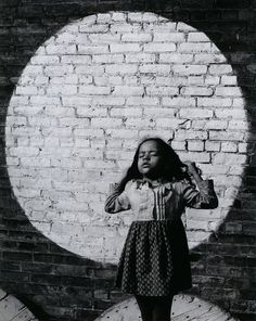 Arthur Tress - A young girl in painted spotlight. New York City, 1968. S)