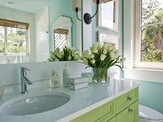 HGTV Dream Home Jacksonville, FL Twin Suite Bathroom : Natural quartz tops the apple-green vanity, where an oversized mirror reflects light from the opposite-facing window and creates the illusion of extra square footage. Tropical Bathroom, Bathroom Pictures, Bathroom Ideas, Bathroom Mirrors, Bathroom Colors, Bathroom Renovations, Bathroom Faucets, Master Bathroom, Cozy Bathroom