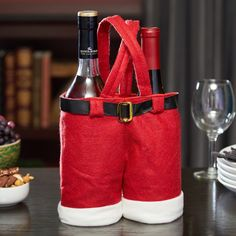 Your bottles will wassail along, singin' a song, side by side in this Santa Pants wine bottle holder. Although silly gifts are most appropriate at drunken celebrations, these little pants will likely become a favorite piece of holiday decor. Wine Bottle Centerpieces, Wedding Wine Bottles, Wine Bottle Candles, Painted Wine Bottles, Wine Bottle Holders, Wine Bottle Crafts, Wine Glass, Decorated Bottles, Fun Christmas