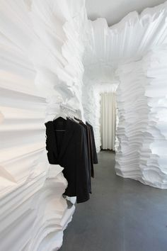 Richard Chai Store Retail Installation, New Yorks cavern-like store is an original exhibition space for the store's items. Not only were the products emphasized, but cool pathways were directing the visitors towards them. This way, the connection with the customer is more long-lasting, as the impact of this unconventional type of interior is stronger than that of a common shop.