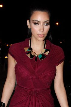 Kim Kardashian Photos Photos - Kim Kardashian highlights her shapely figure in a plum-coloured frock. Kim  looked smitten as she arrived at BOA steakhouse with boyfriend Kris Humphries, a forward the the New Jersey Nets. - Kim Kardashian at BOA Steakhouse in Los Angeles