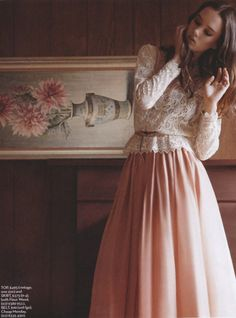 A belted lace blouse and a full pink skirt. So soft and feminine.